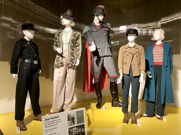 6 mannequins displaying movie costumes from 2019 movie Jojo Rabbit