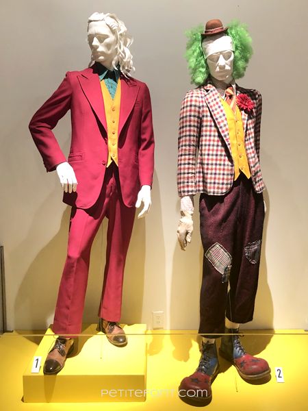 2 mannequins displaying movie costumes from 2019 The Joker