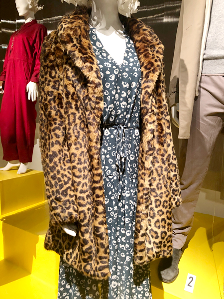 Close up of a blue print dress and leopard print jacket from the movie Last Christmas