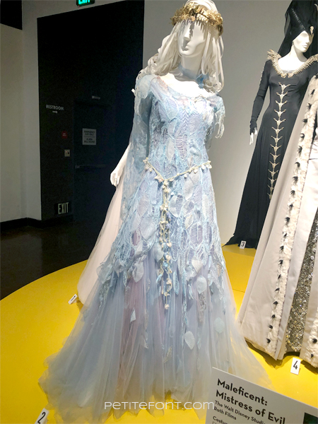 Mannequin wearing blue lace and organza dress, the movie costume from 2019's Maleficient: Mistress of Evil