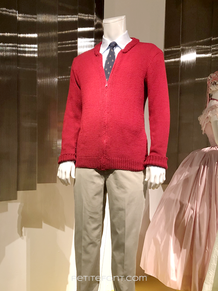 Mannequin wearing the iconic red sweater, tie, and khaki pants from the Mr. Rodgers movie