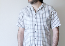 Young man looking off camera in plaid version of McCall's 7206 bowling sewing patter