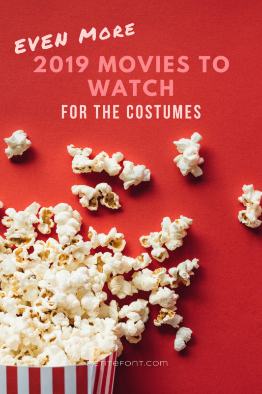 Popcorn box overflowing onto a red background with pink text that reads Even More 2019 Movies to Watch for the Costumes