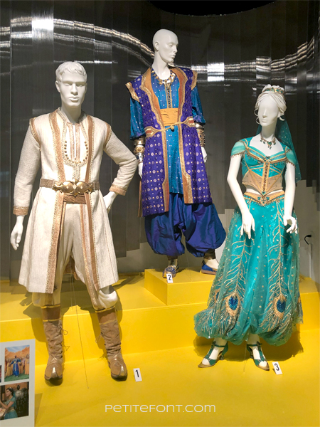 Display of Aladdin costumes at the 2020 movie costumes exhibit at FIDM