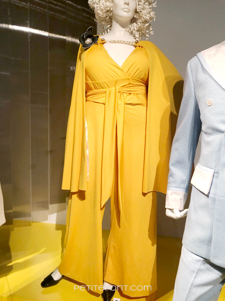 Yellow jumpsuit and cape worn by Da'Vine Joy Randolph in My Name is Dolemite, at the 2020 movie costumes exhibit at FIDM