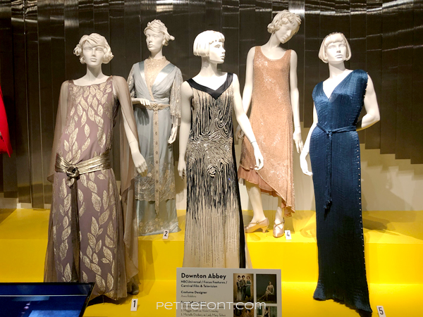 Display of Downton Abbey costumes at the 2020 movie costumes exhibit at FIDM