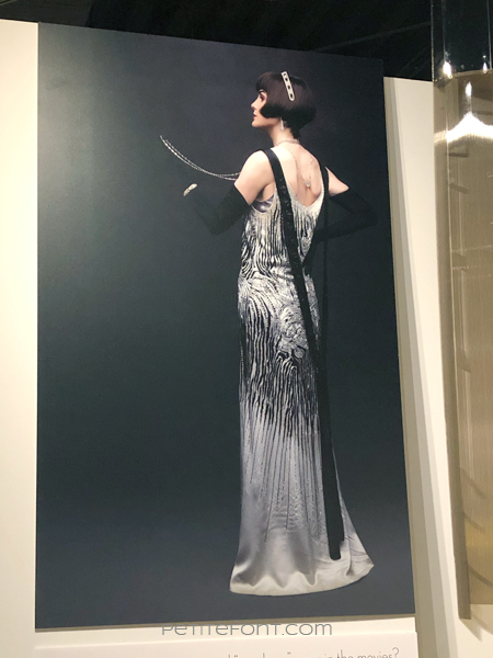 Poster for the Downton Abbey movie showing the back of Michelle Dockery's sequined dress, as seen at the 2020 movie costumes exhibit at FIDM