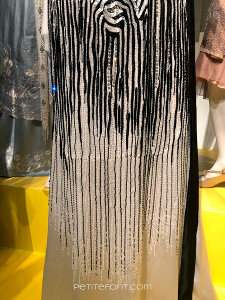 Close up shot of Michelle Dockery's sequined dress from Downton Abbey, at the 2020 movie costumes exhibit at FIDM