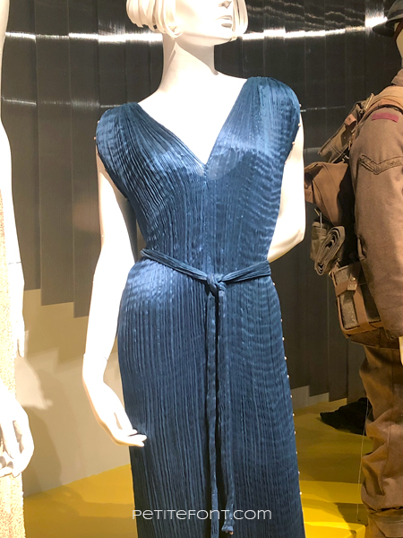 Mannequin wearing Michelle Dockery's blue pleated evening gown from Downton Abbey, at the 2020 movie costumes exhibit at FIDM