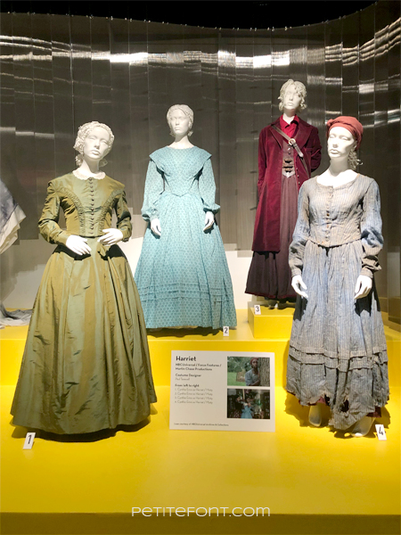 Display of Harriet costumes at the 2020 movie costumes exhibit at FIDM