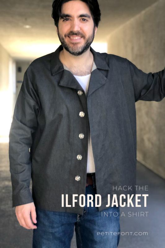 Dark haired man wearing an open front dark charcoal grey Ilford jacket as a shirt, with jeans. Text overlay reads Hack the Ilford Jacket into a Shirt, PetiteFont.com