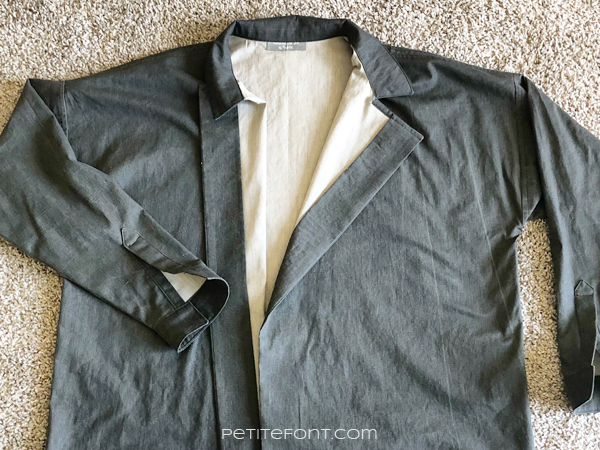 Flat lay of a grey shirt with beige insides showing the Ilford Jacket facing hack fail
