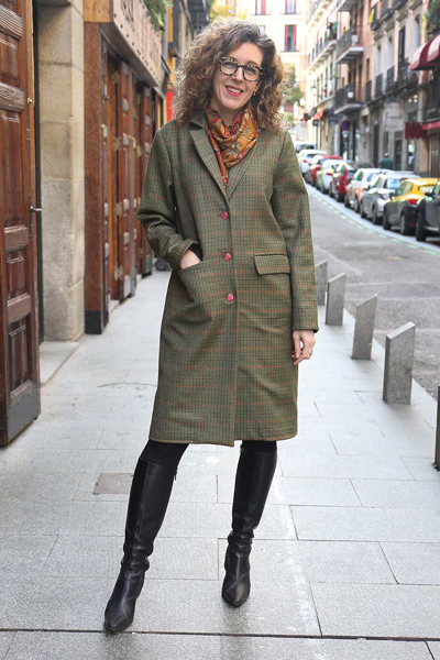 Woman posing on the street in a long tweed coat, modeling the Liesl & Co Chaval coat