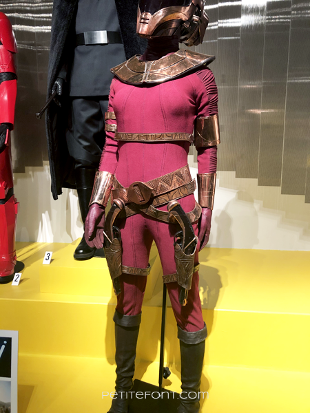 Red Zorii Bliss jumpsuit from Star Wars display at the 2020 movie costume exhibit at FIDM