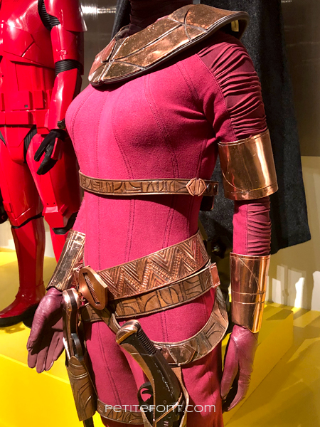 Detail shot of the arm and seaming of the red Zorii Bliss jumpsuit from Star Wars display at the 2020 movie costume exhibit at FIDM