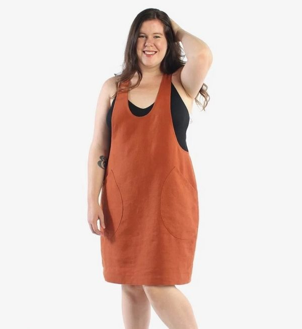Helen in an orange York pinafore