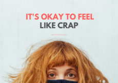 Top of a redheaded woman's face hiding in a black sweater with text above that reads It's Okay to Feel Like Crap PetiteFont.com