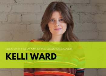 Image of a woman in a striped long sleeve shirt standing in front of a white brick wall. Text reads Q&A with Sew My Style 2020 Designer Kelli Ward, PetiteFont.com