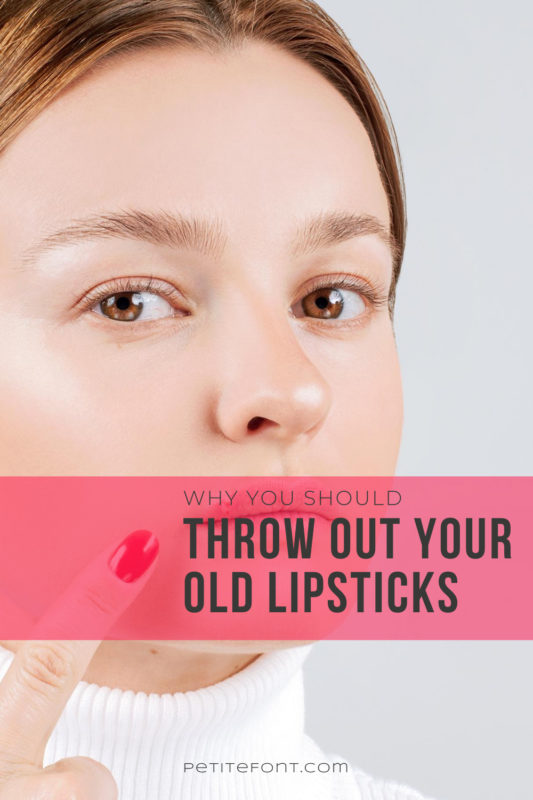 A woman's face is overlayed with a text box over a cold sore on her lips that she is pointing to. Black text overlay in a red box reads Why You Should Throw Out Your Old Lipsticks