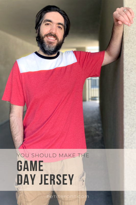 Ryan smiling at the camera with one arm against the wall while wearing a red, white, and black t-shirt. Text overlay reads You should make the Game Day Jersey.