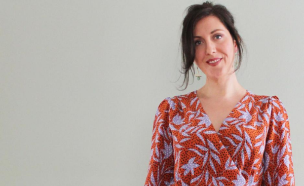 Image of Pattern Scout owner and designer Casey Sibley. She is wearing her hair up, and an orange and lavender cross-front blouse.