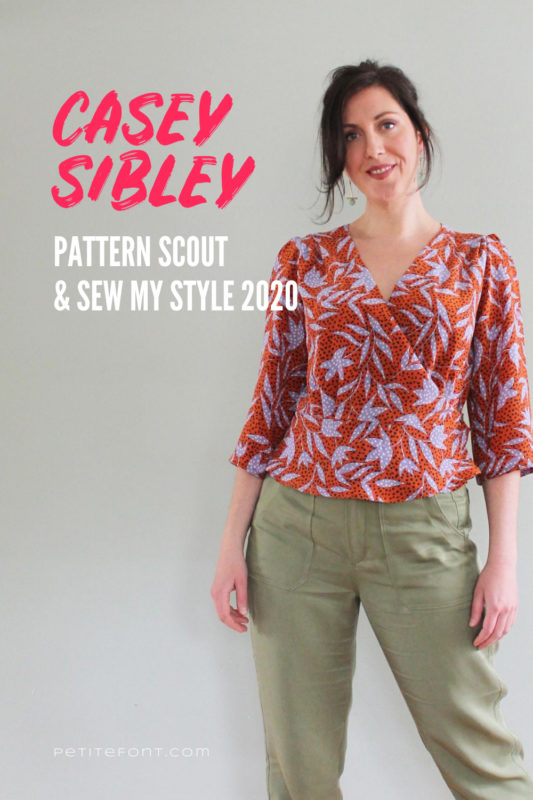 Image of Pattern Scout owner and designer with red and white text overlay that reads Casey Sibley Pattern Scout & Sew My Style 2020. She is wearing her hair up, an orange and lavender cross-front blouse, and light olive trousers.