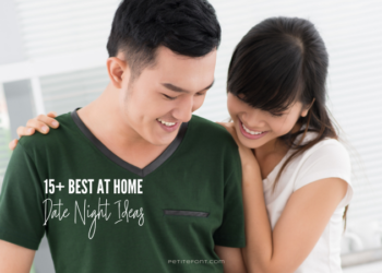 An Asian stands smiling and looking down in a white room. The man in a dark green v-neck t-shirt and woman with her arms around him looking over his shoulder is wearing a white t-shirt. Text reads 15+ best at home date night ideas