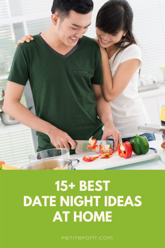 An Asian couple stands smiling at the counter chopping vegetables. The man in a dark green v-neck t-shirt holds the knife and the woman with her arms around him looking over his shoulder is wearing a white t-shirt. Text in a green box reads 15+ best at home date night ideas