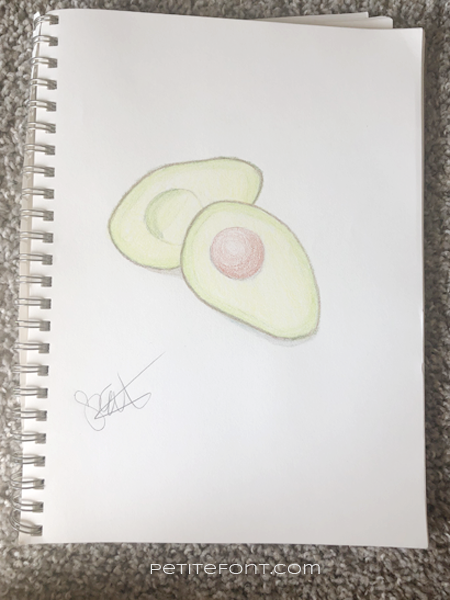 Crayon drawing of an avocado signed by artist