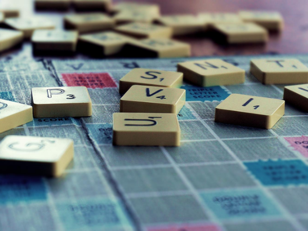 Zoomed in view of Scrabble letters on a game board