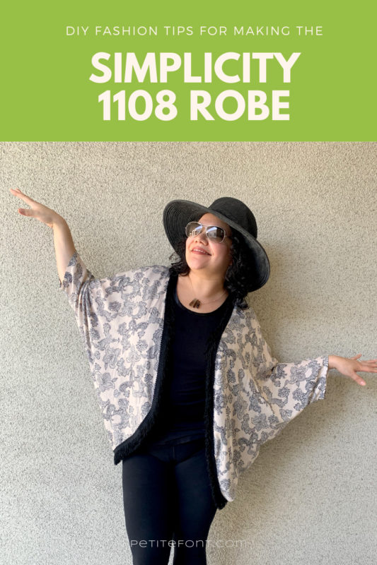 "A picture of a woman in a hat and sunglasses, leaning against a light stucco wall. Her arms are out like a bird as she looks up. She has a fringed peach and black paisley robe on over an all black outfit. Text overlay reads ""DIY Fashion Tips for Making the Simplicity 1108 Robe."""