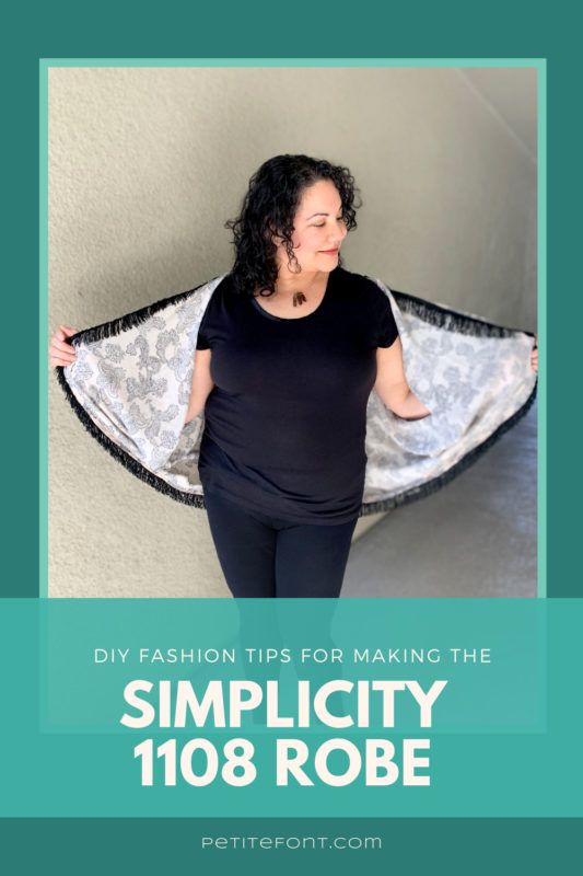 "Curly haired woman looking down to the side while holding out the edges of her fringed robe, showing her all black outfit underneath. The picture is inset in a teal frame on a darker turquoise background. Text overlay reads ""DIY fashion tips for making the Simplicity 1108 robe"""