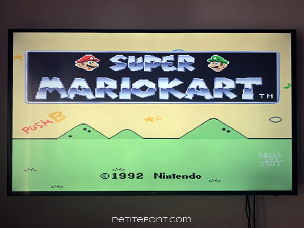 Television with the starting screen of Super MarioKart on.