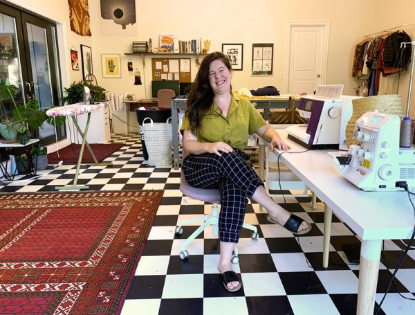 Helen sitting in her sewing space at Helen's Closet HQ