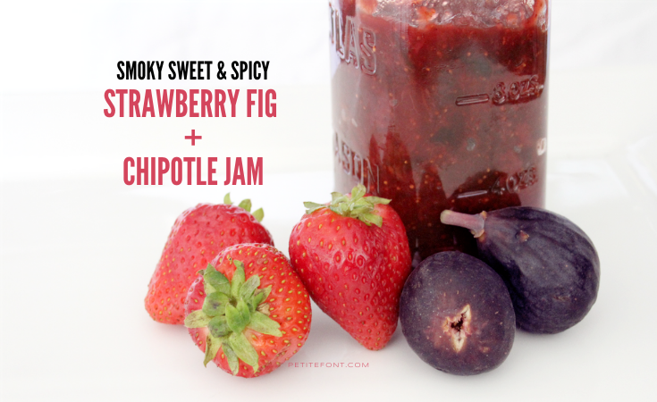 """A jar of red jam on a white background with intact strawberries and figs in front of it. Text overlay reads """"smoky sweet & spicy strawberry fig and chipotle jam"""""""