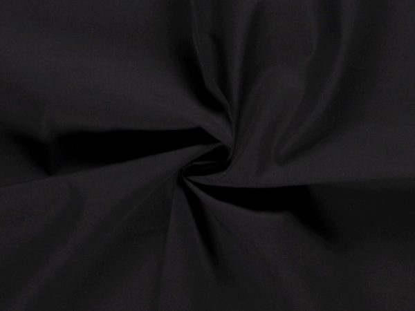 Black poly-cotton poplin fabric bunched together