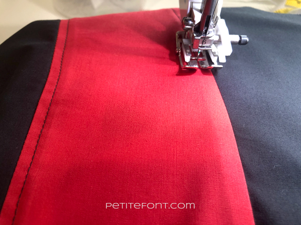 Closeup of the red and block colorblocking and topstitching on M7206