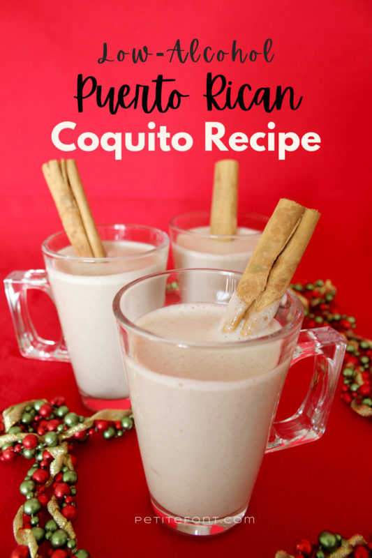 3 cups of coquito on a red background with Christmas garland around. Text overlay reads Low Alcohol Puerto Rican Coquito Recipe