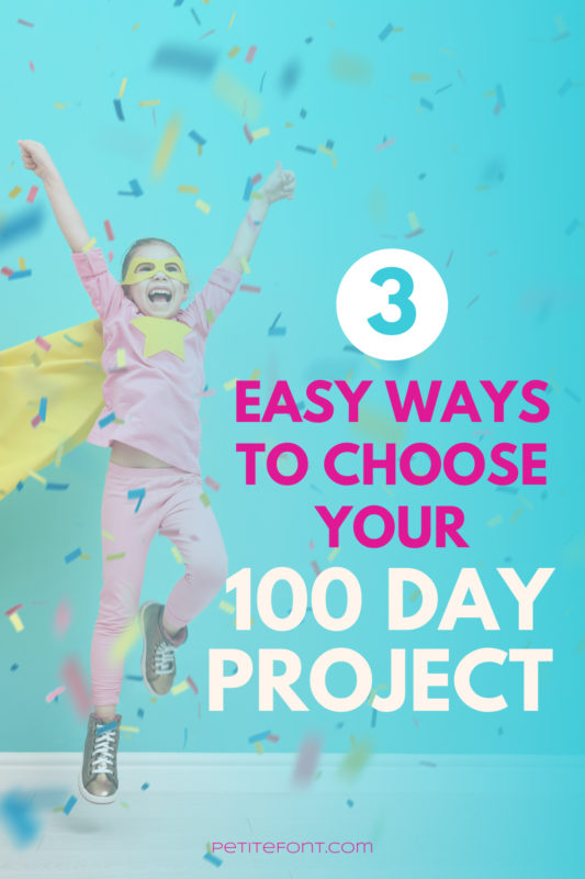 Little girl in pink PJs and a yellow cape jumping in the air while confetti falls around her. A turquoise wall is behind her. Text overlay reads 3 easy ways to choose your 100 day project