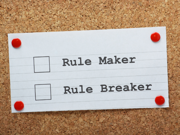Index card tacked to a corkboard with two options: rule maker or rule breaker