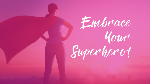 "Woman in a cap overlooking a city scape, arms on her hips. Text overlay reads ""embrace your superhero!"""