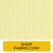Swatch of yellow seersucker stripe fabric from Fabric.com