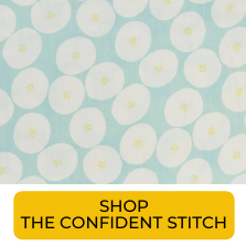 Swatch of white circles on light blue background gauze fabric from The Confident Stitch