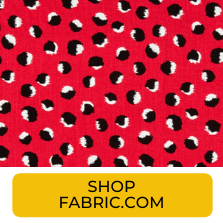 Swatch of red with black and white abstract dots fabric from Fabric.com