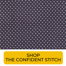 Swatch of dark purple and grey polka dot shirting fabric from The Confident Stitch